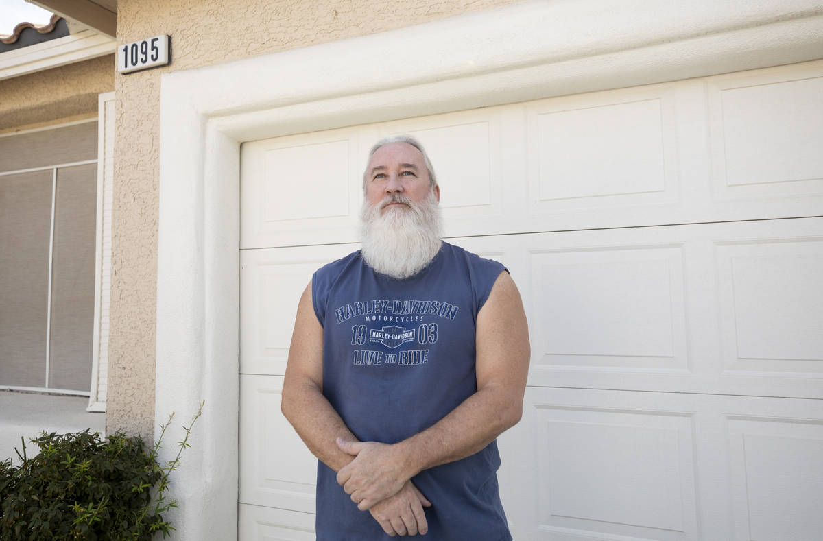 Las Vegas landlord Bob Smith, 57, is photographed outside of his previous tenant's rental home, ...