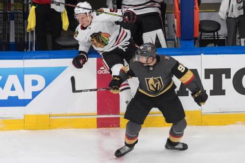 Vegas Golden Knights' Tomas Nosek (92) checks Chicago Blackhawks' Connor Murphy (5) during the ...