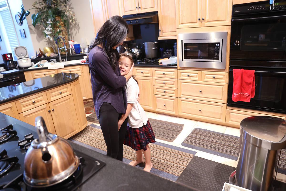Prem Premsrirut gets her daughter Anya, 9, ready for school at their Las Vegas home Monday, Sep ...