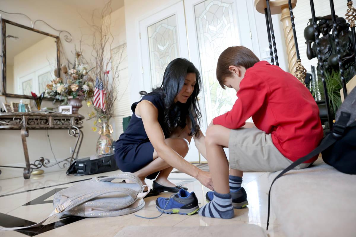 Prem Premsrirut gets her son Ivan, 7, ready for school at their Las Vegas home Monday, Sept. 28 ...