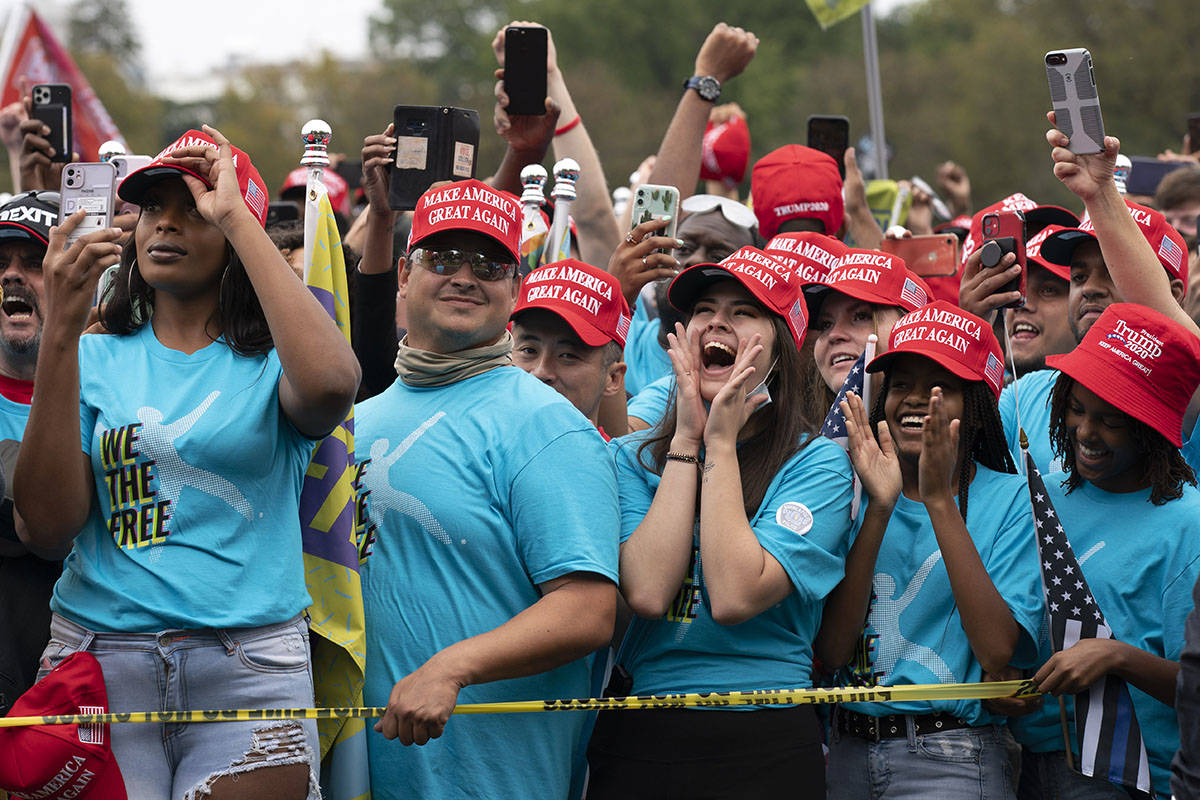 Supporters of President Donald Trump rally at The Ellipse, before entering to the White House, ...