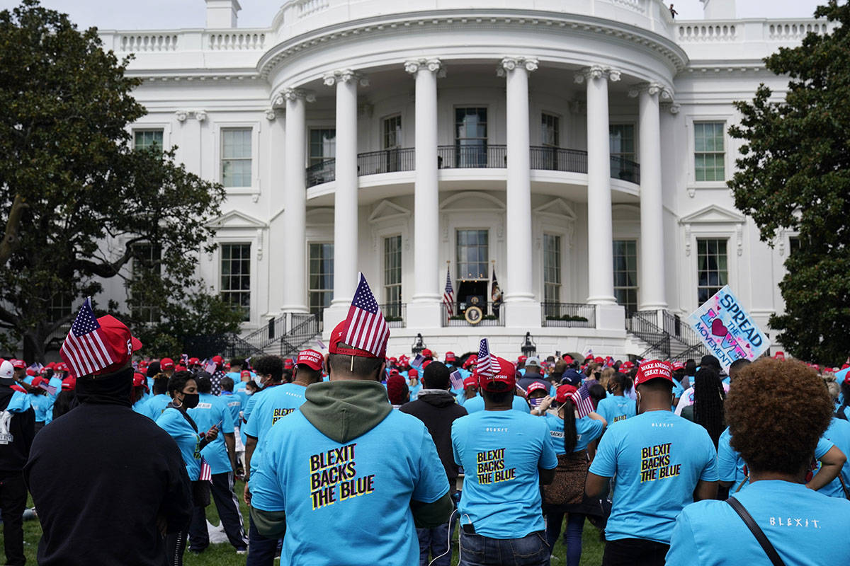 A crowd of President Donald Trump supporters gather on the South Lawn to listen to Trump speak ...