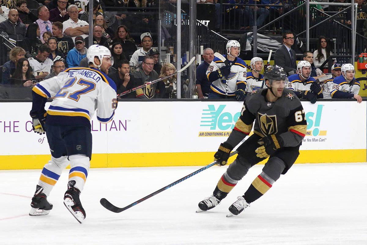 Vegas Golden Knights left wing Max Pacioretty (67) skates past St. Louis Blues defenseman Alex ...