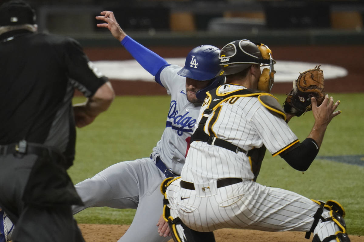Los Angeles Dodgers' A.J. Pollock (11) beats the throw to score on a single by Joc Pederson dur ...