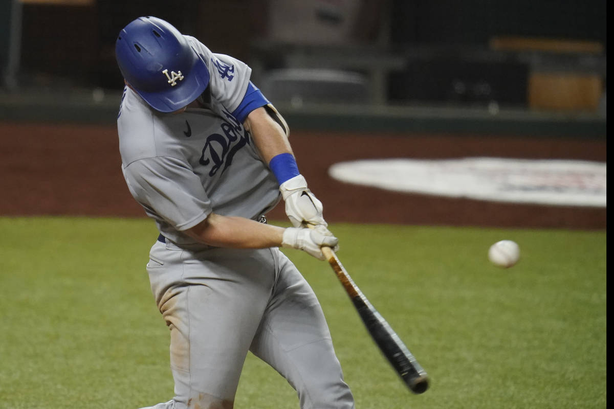 Los Angeles Dodgers' Will Smith hits in Game 3 of a baseball National League Division Series ag ...