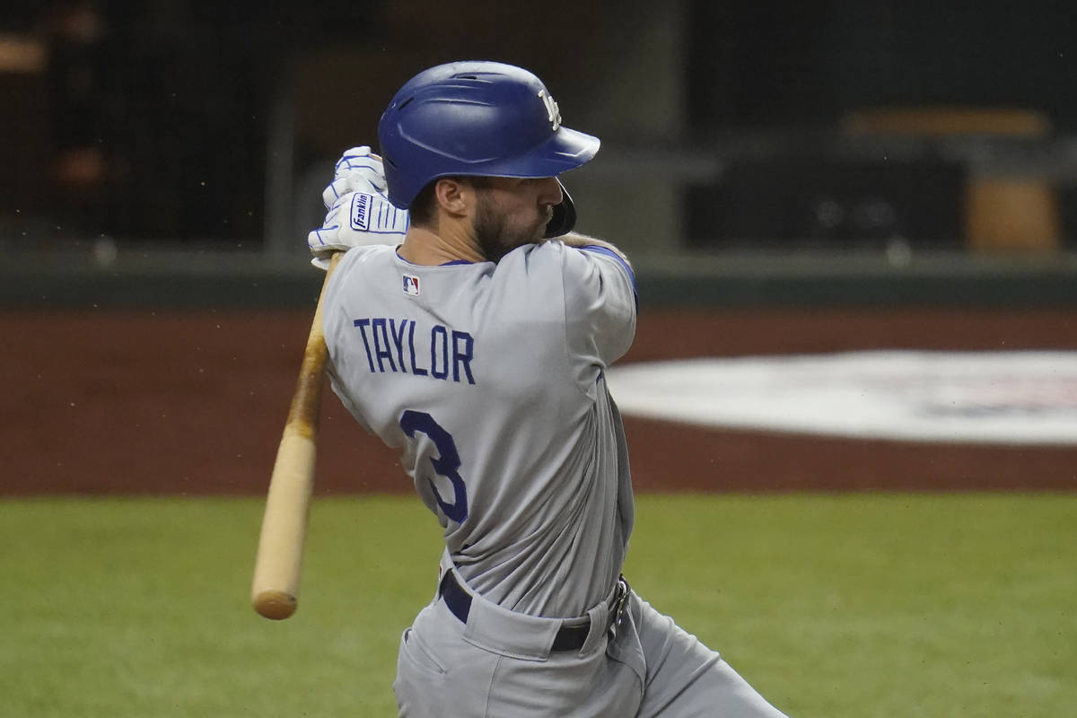 Los Angeles Dodgers' Chris Taylor bats in Game 3 of a baseball National League Division Series ...