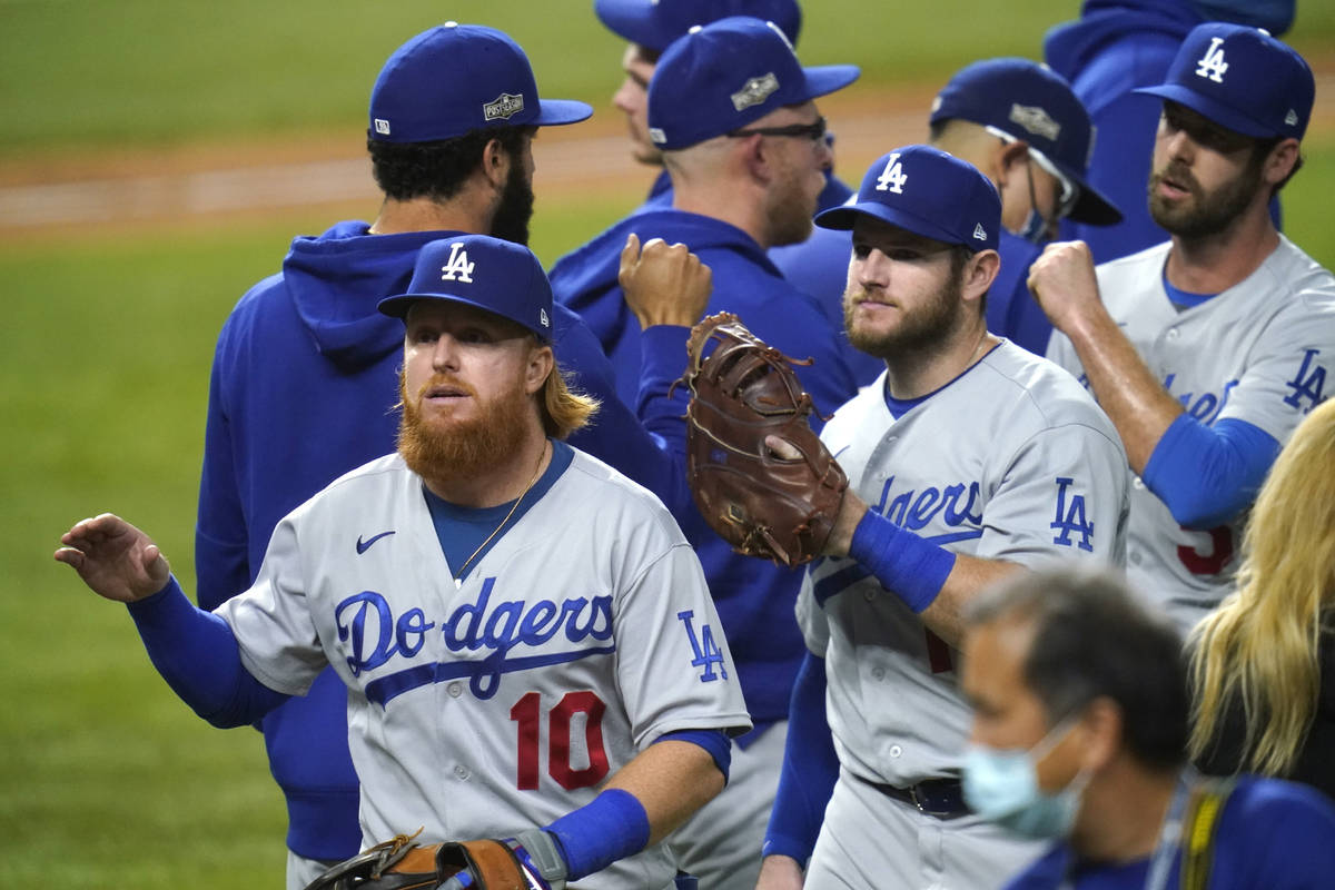 Los Angeles Dodgers' Justin Turner (10) and his teammates celebrate after defeating the San Die ...