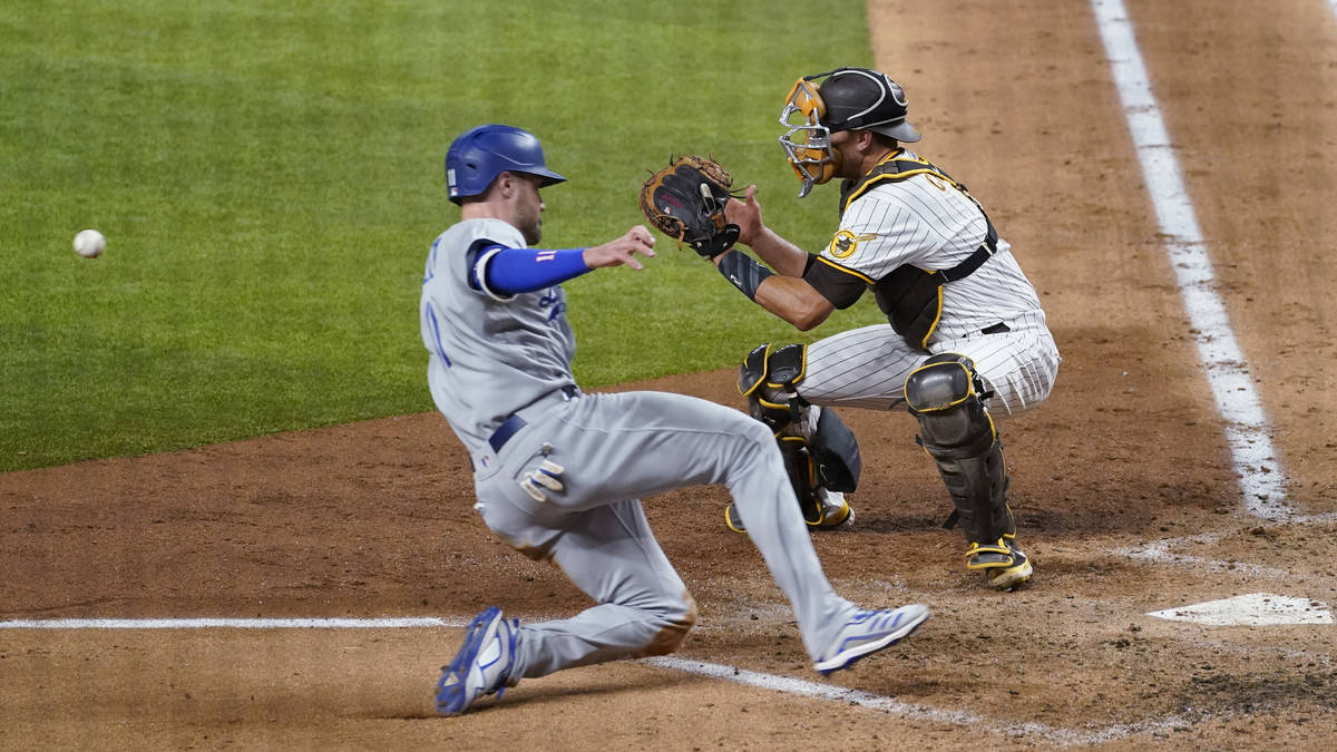 Los Angeles Dodgers' A.J. Pollock, left, beats the throw to score on a single by Joc Pederson d ...