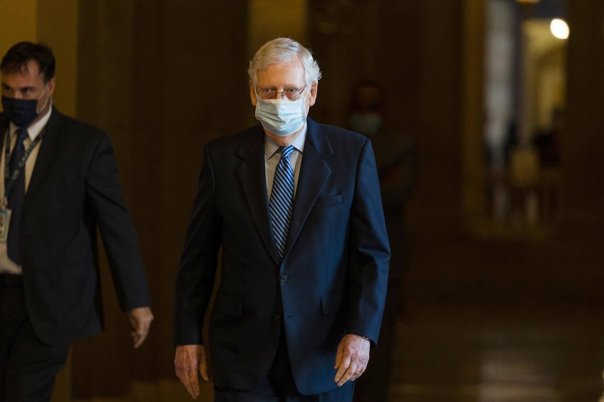 Senate Majority Leader Sen. Mitch McConnell of Ky. walks towards the Senate floor on Capitol Hi ...