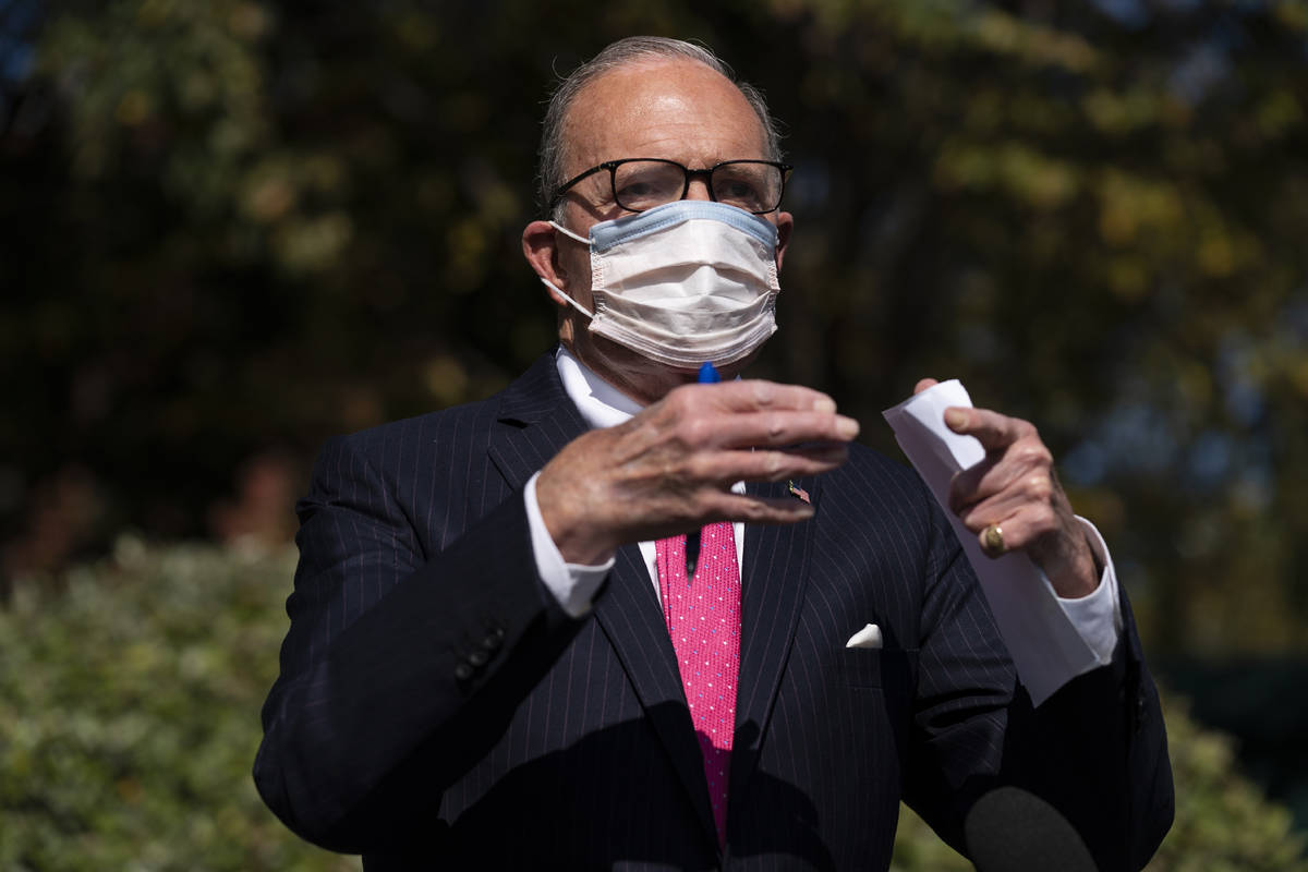 White House chief economic adviser Larry Kudlow talks with reporters outside the White House ab ...