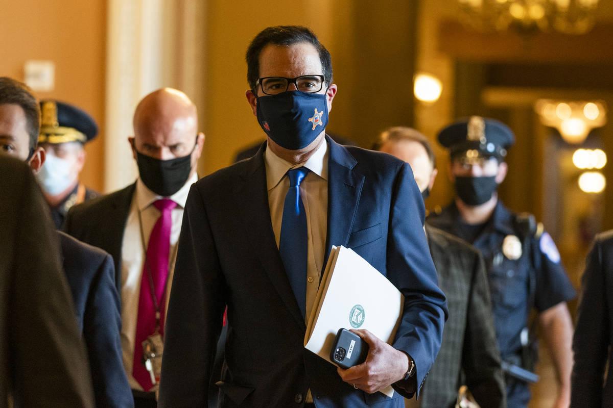 Treasury Secretary Steven Mnuchin, walks from the office of Senate Majority Leader Sen. Mitch M ...