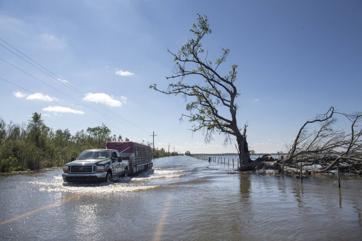 Floodwater covers a road just southeast of Lake Charles, La., following Hurricane Delta on Satu ...