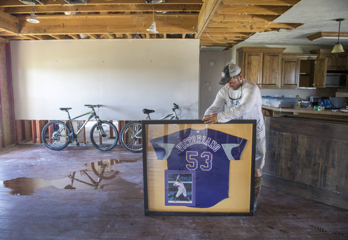 A former baseball player with LSU, Gerard Victoriano, Jr., salvages his old jersey the morning ...
