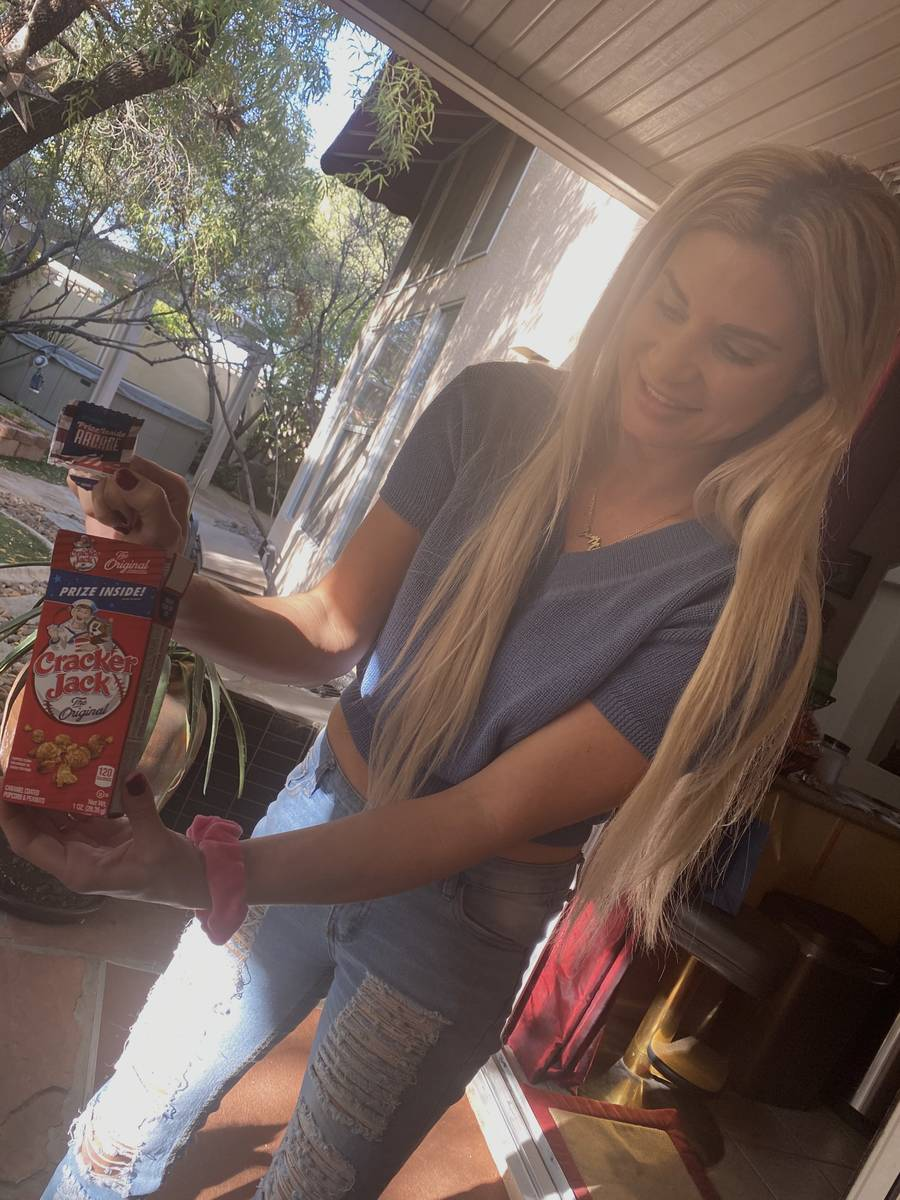 Dani Elizabeth shows off her Cracker Jack box containing her engagement ring from Murray Sawchu ...