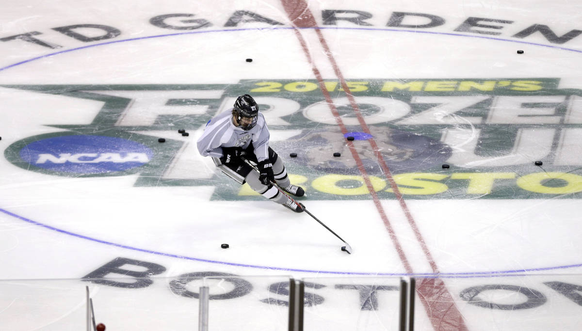 Providence's Kevin Rooney handles a puck during practice in Boston, Friday, April 10, 2015 in p ...