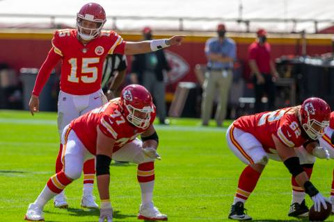 Kansas City Chiefs quarterback Patrick Mahomes (15) calls a play at the line of scrimmage as of ...