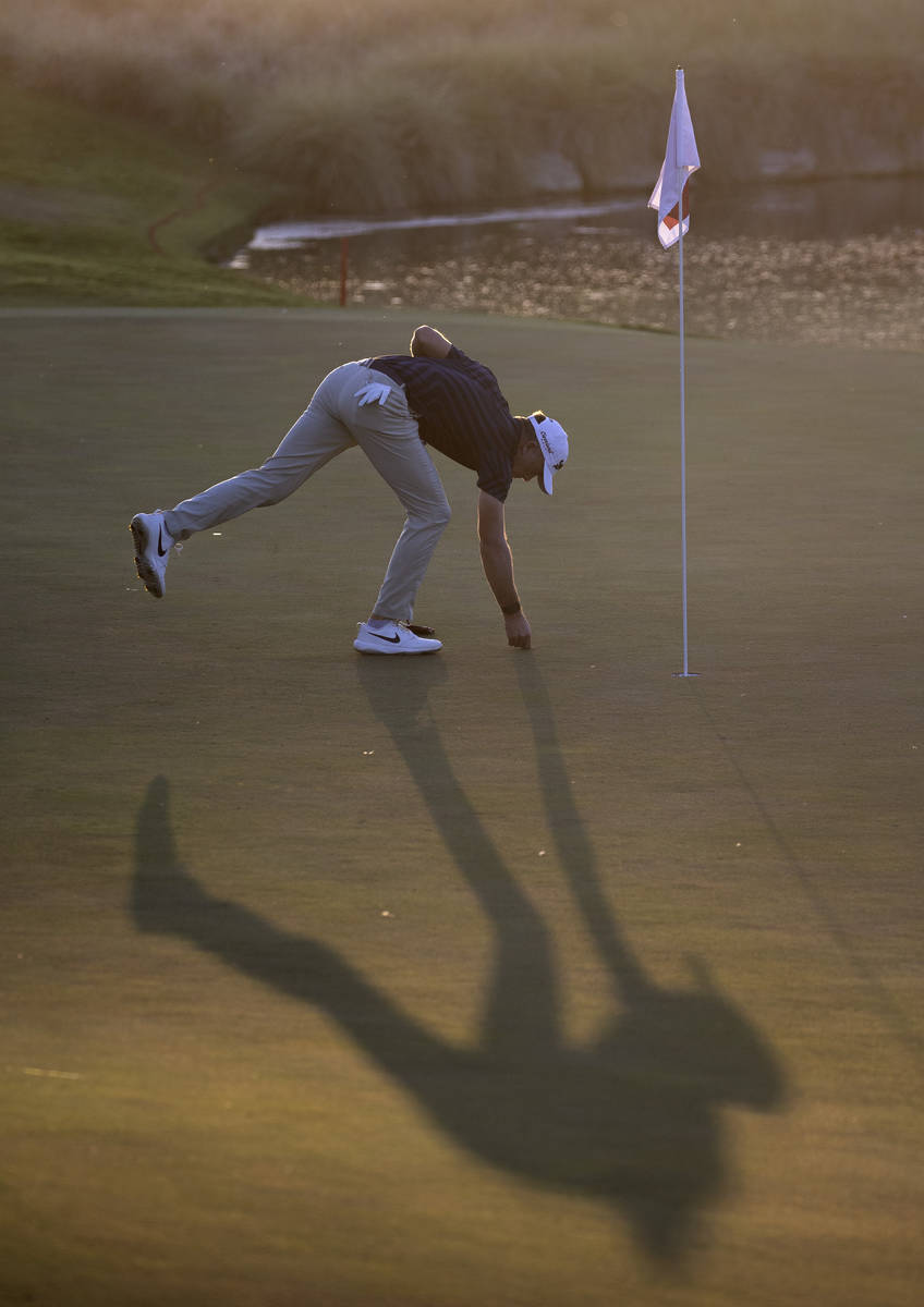 Martin Laird marks his ball on the 17th hole during a playoff in the final round of the 2020 Sh ...