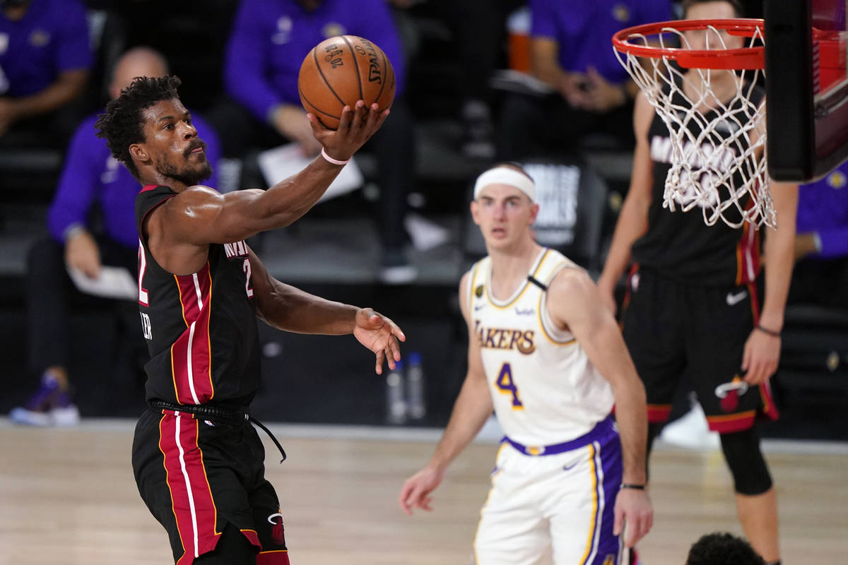 Miami Heat's Jimmy Butler (22) goes up for a basket during the second half in Game 6 of basketb ...