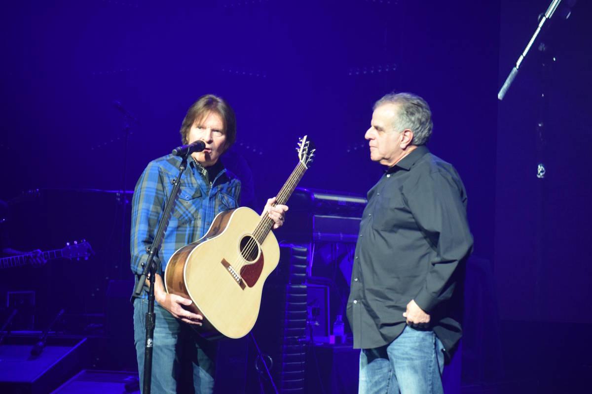 Rock great John Fogerty presents a new Gibson guitar to Las Vegas Veterans Crisis Intervention ...