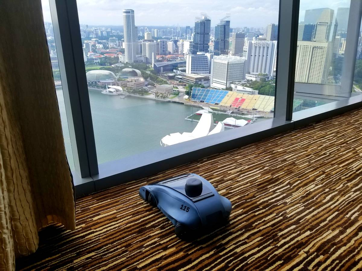 An earlier prototype of Maidbot's cleaning robot Rosie in 2018 cleaning a hotel guestroom. (Cou ...