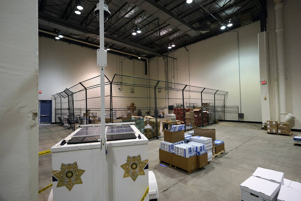 A security camera is positioned to monitor a cage where mail-in ballots will be stored after ar ...