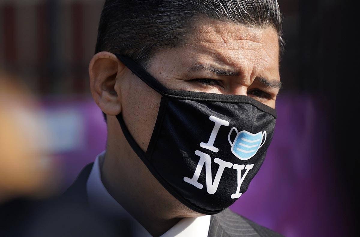 New York City Schools Chancellor Richard Carranza wears a mask during a news conference at the ...