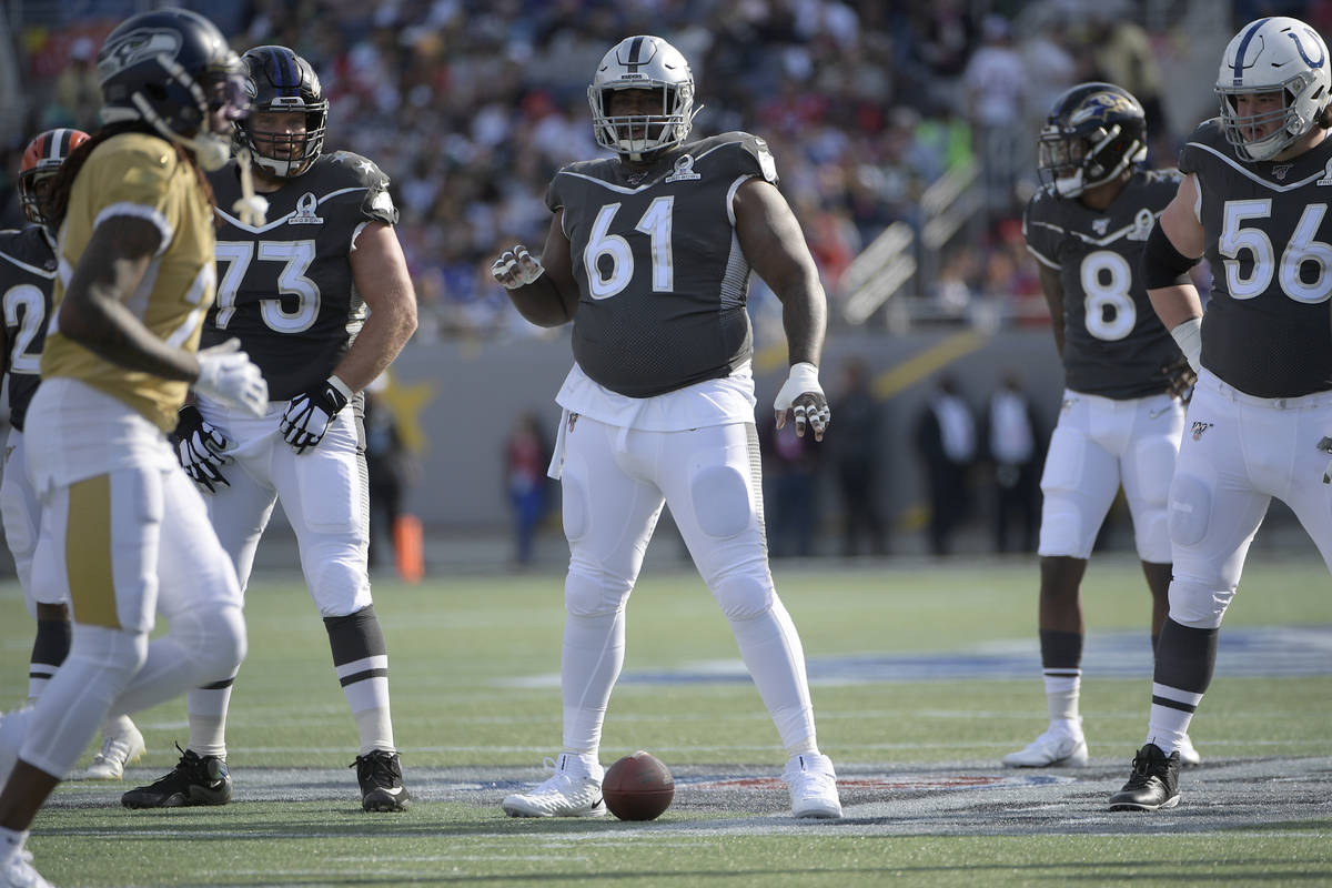 AFC center Rodney Hudson (61), of the Oakland Raiders, sets up for a play during the first half ...