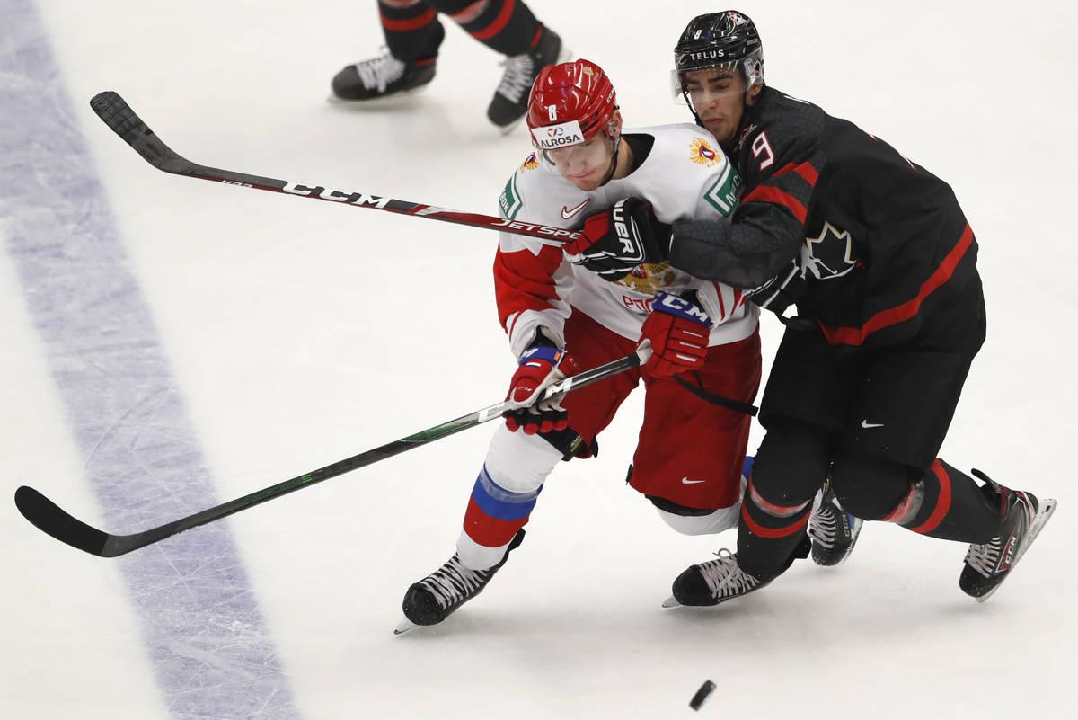 Canada's Joe Veleno, right, challenges Russia's Ivan Morozov during the U20 Ice Hockey Worlds g ...