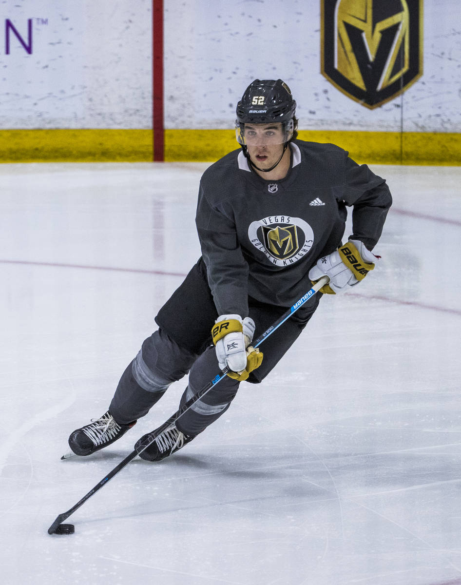 Vegas Golden Knights defenseman Dylan Coghlan (52) controls the puck during practice at City Na ...