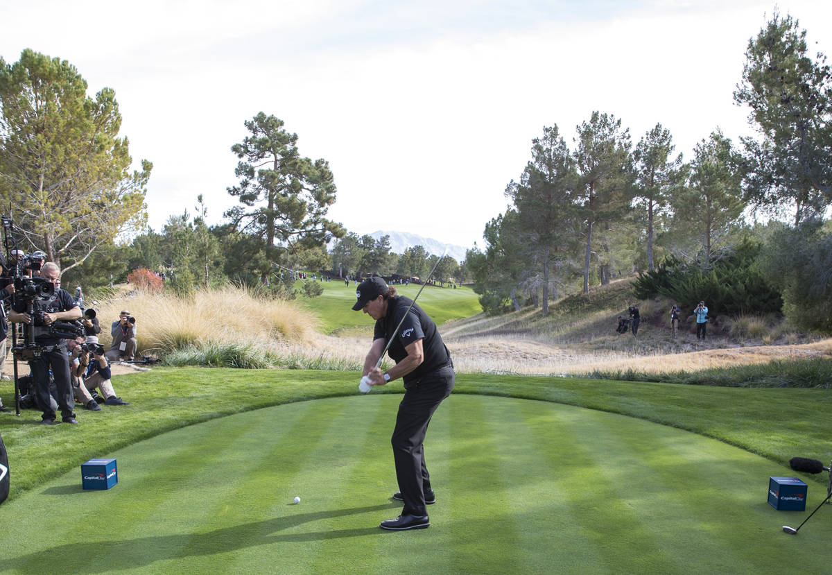 Phil Mickelson hits from the second tee box during The Match at Shadow Creek Golf Course in Nor ...