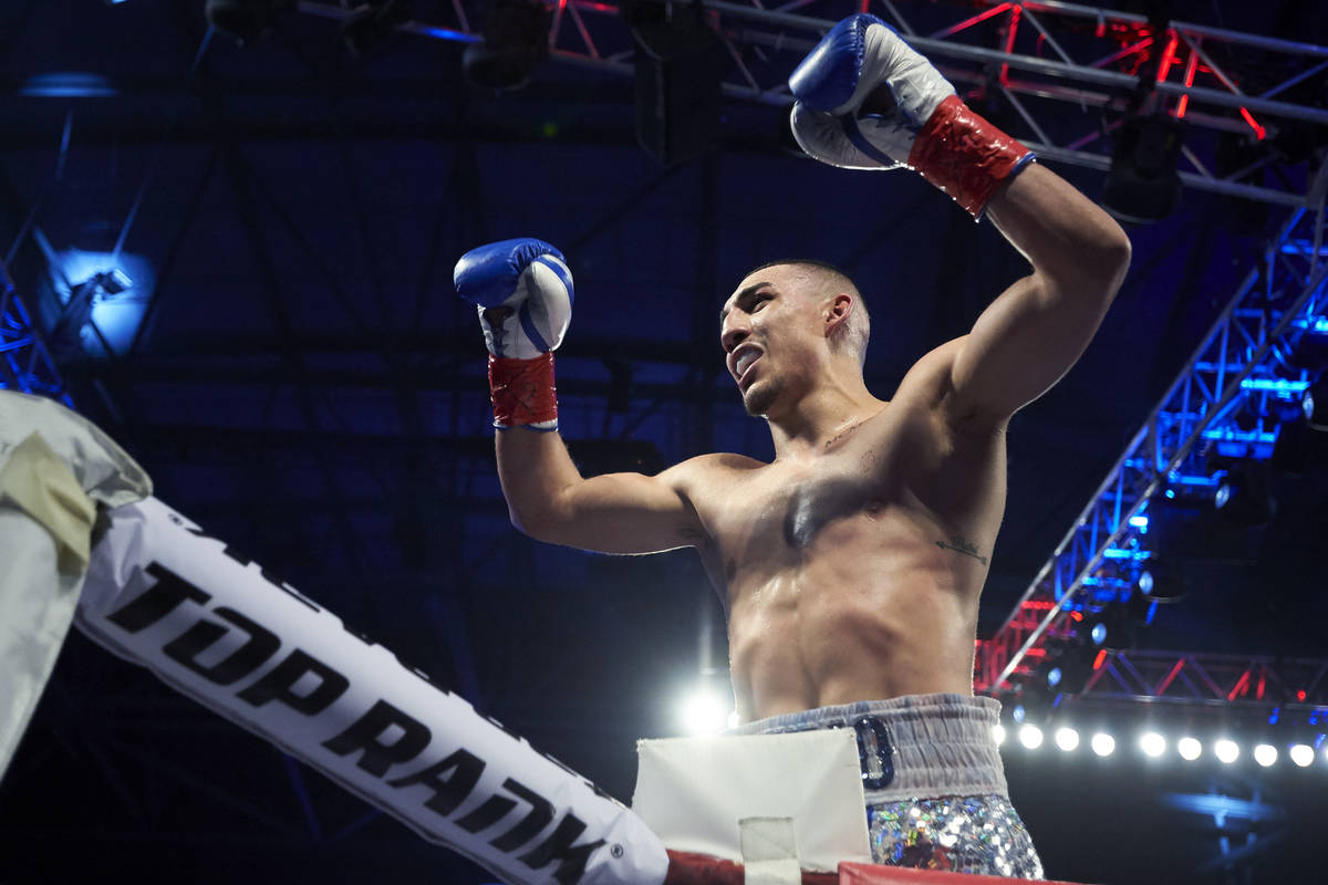Teofimo Lopez celebrates after defeating Diego Magdaleno during a lightweight boxing match Satu ...