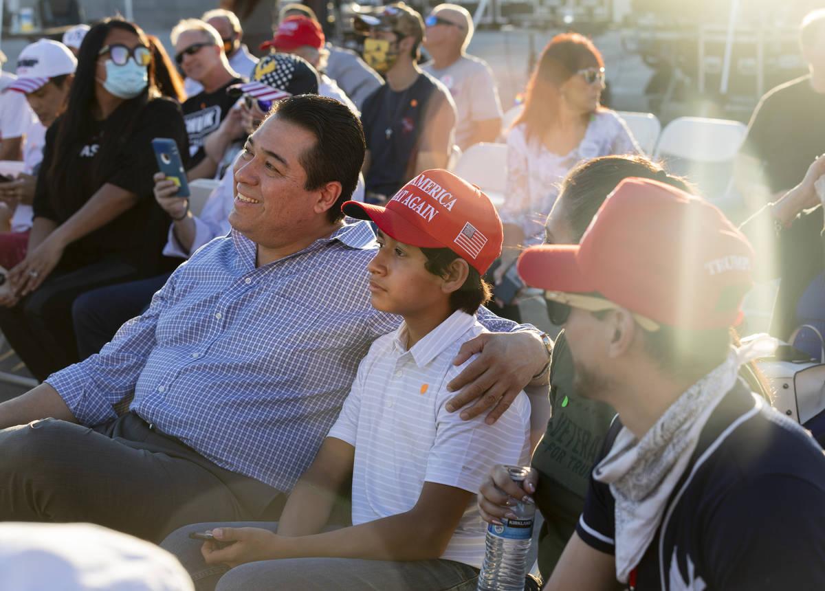 Jesus Marquez, 45, center left, and his son Jesus Marquez Jr.,12, of Las Vegas Donald Trump Jr. ...