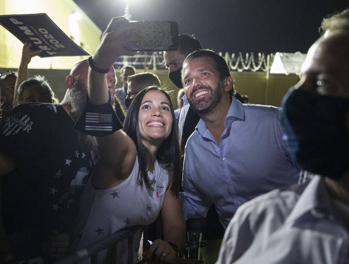 Claire McGartland, of Las Vegas, left, takes a photograph with Donald Trump Jr. after he spoke ...