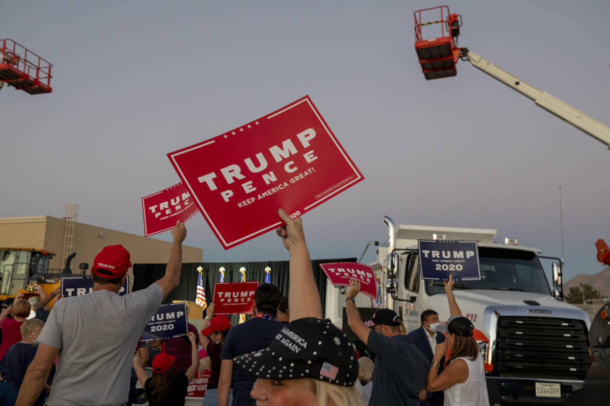 Attendees cheer waiting for Donald Trump Jr. to speak at a campaign event for President Trump o ...