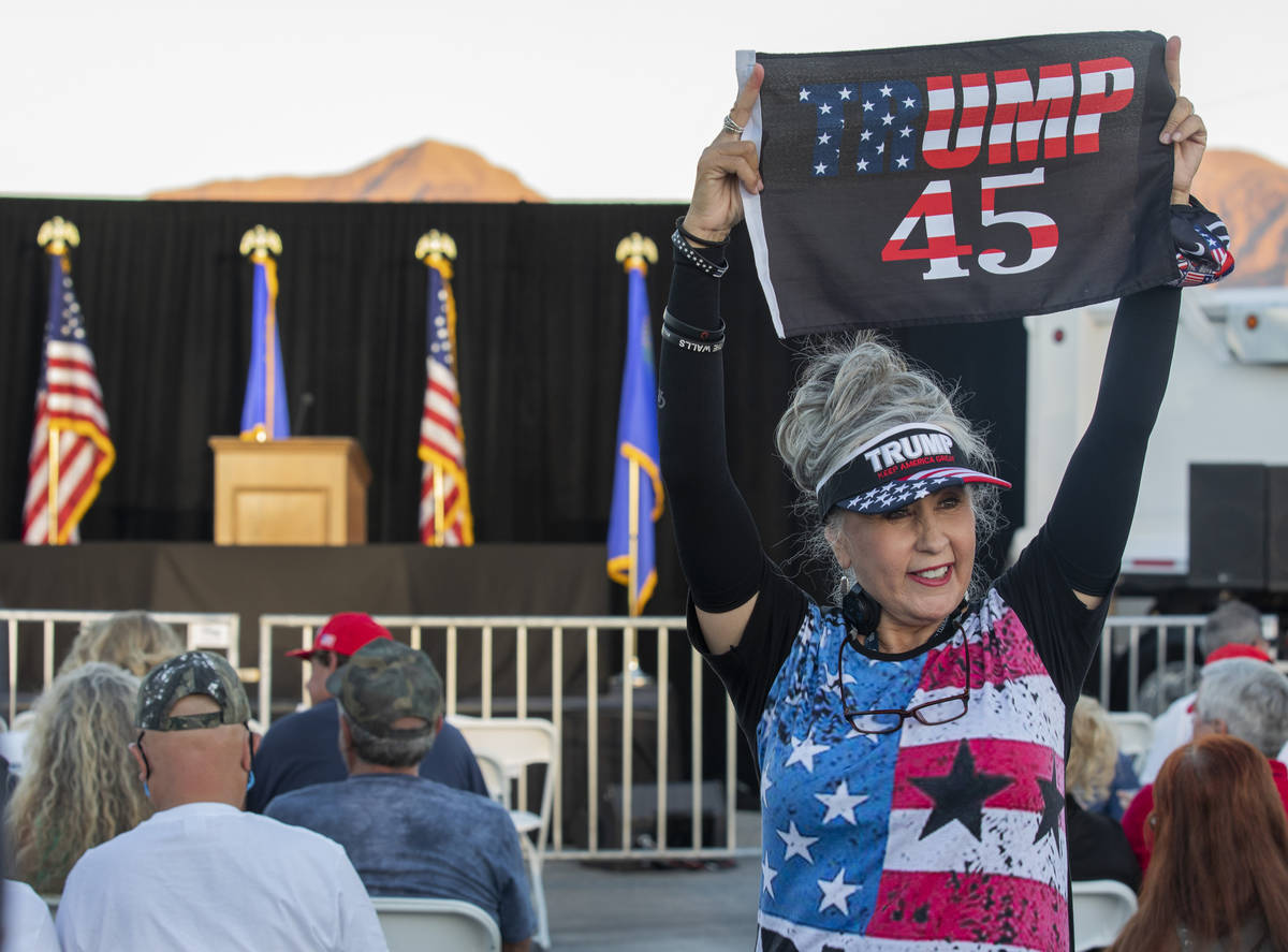 Sharon Abila, 66, of Las Vegas, holds a Trump flag up before Donald Trump Jr. speaks at a campa ...
