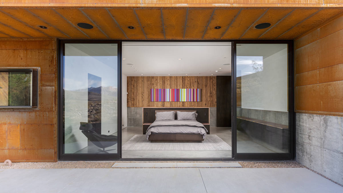 The master bedroom leads to a backyard area that leads to hiking trails, which run throughout t ...