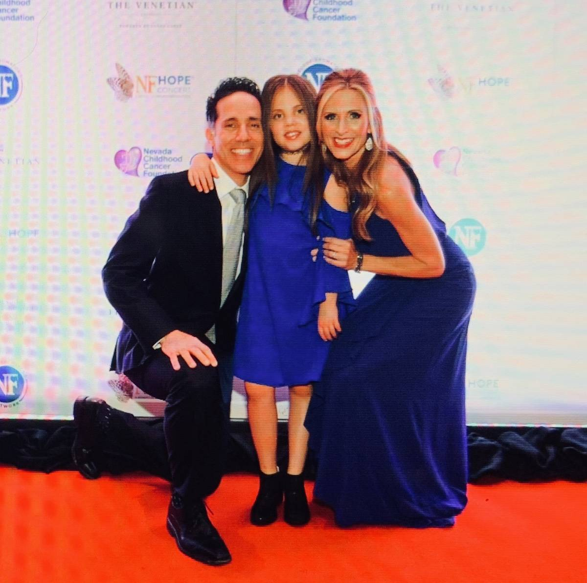 Jeff, Emma and Melody Leibow are shown on the red carpet before the eighth annual NF Hope Conce ...