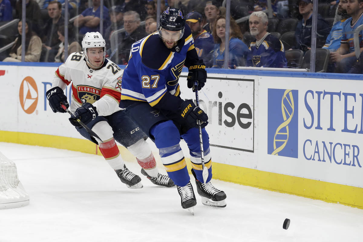 FILE - In this March 9, 2020, file photo, St. Louis Blues' Alex Pietrangelo (27) and Florida Pa ...