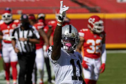 Las Vegas Raiders wide receiver Henry Ruggs III (11) celebrates after making a big catch in the ...