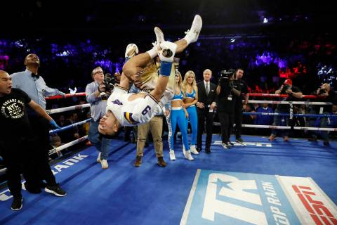 Teofimo Lopez flips in the ring after defeating Ghana's Richard Commey by TKO during the second ...