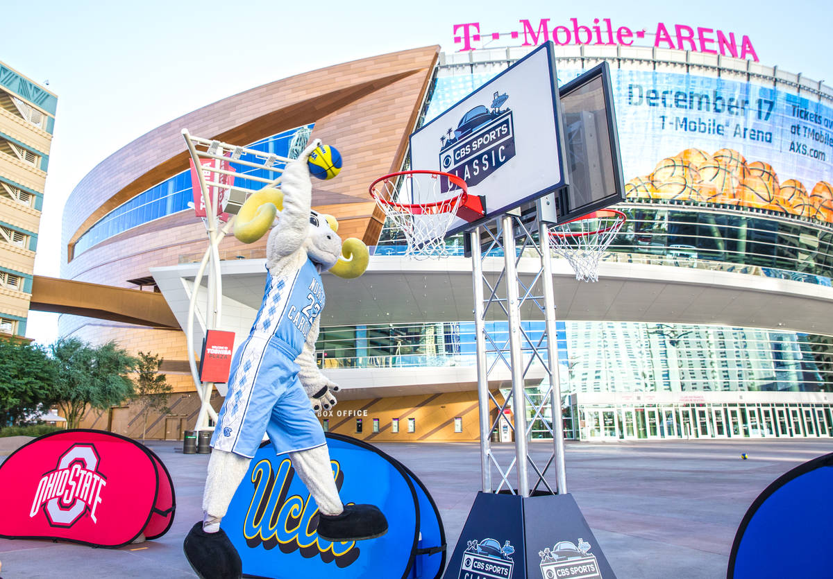 North Carolina mascot Rameses goes up for a dunk on Tuesday, Oct. 11, 2016, outside T-Mobile Ar ...