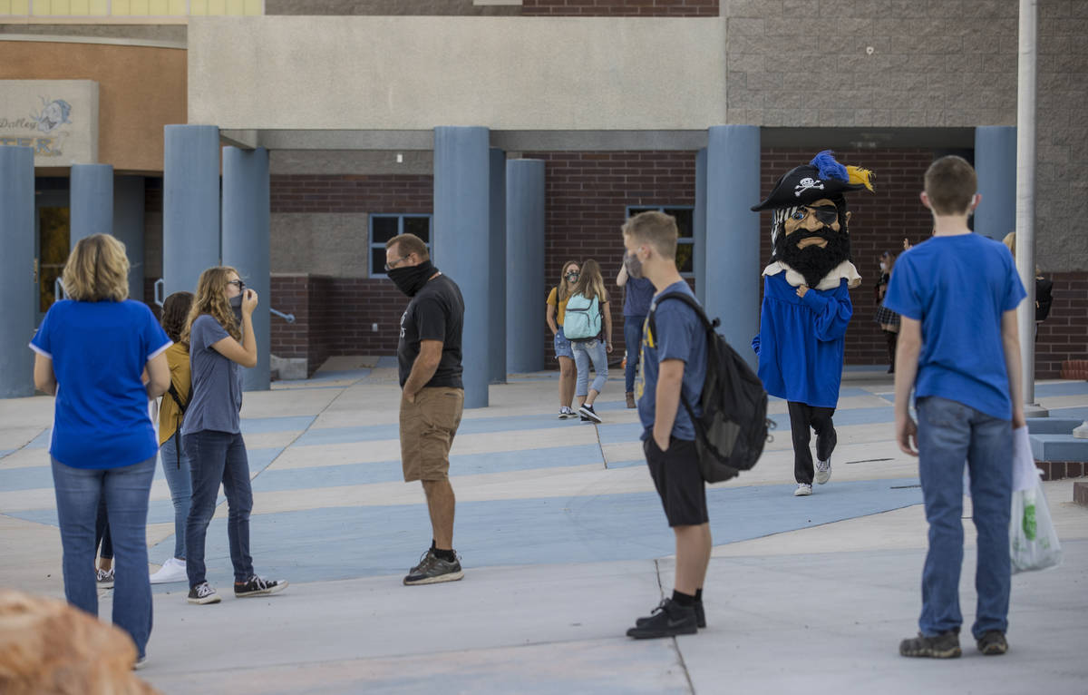 Students and adults gather outside at Moapa Valley High School before the start of classes with ...