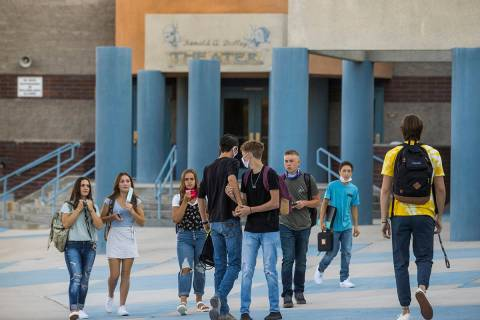 Students greet each other outside at Moapa Valley High School before the start of classes with ...