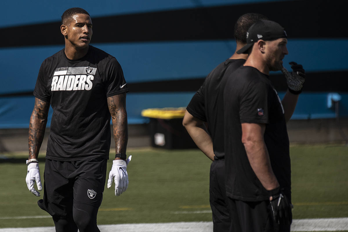 Las Vegas Raiders tight end Darren Waller (83) warms up before the start of their NFL football ...