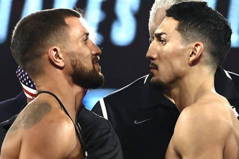 Vasiliy Lomachenko, left, and Teofimo Lopez, right, face off Friday, Oct. 16, 2020, during the ...