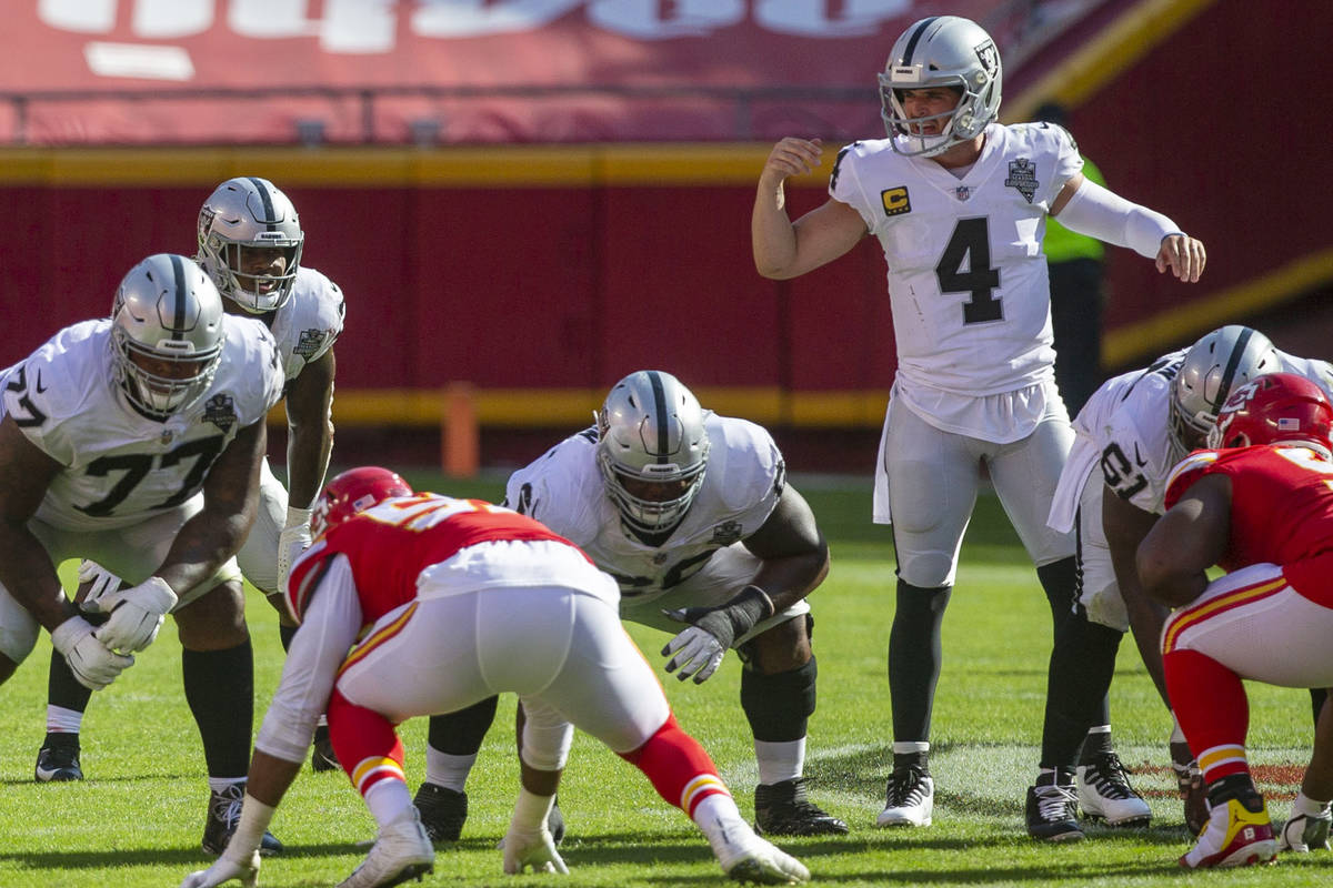 Las Vegas Raiders quarterback Derek Carr (4) audibles a play as offensive linemen Trent Brown ( ...
