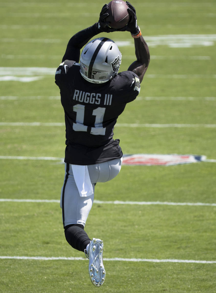 Las Vegas Raiders wide receiver Henry Ruggs III (11) leaps to try and bring down a catch in the ...
