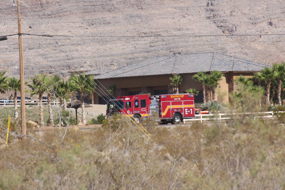 A fire truck responds after a helicopter landed in a lake and sank in Pahrump on Friday, Oct. 1 ...