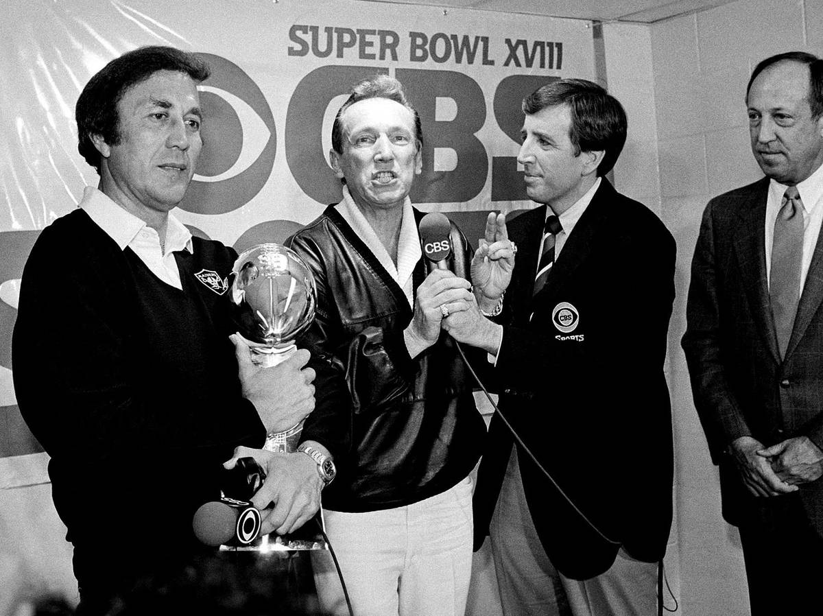 FILE - In this Jan. 23, 1984, file photo, Oakland Raiders coach Tom Flores clutches the Super B ...