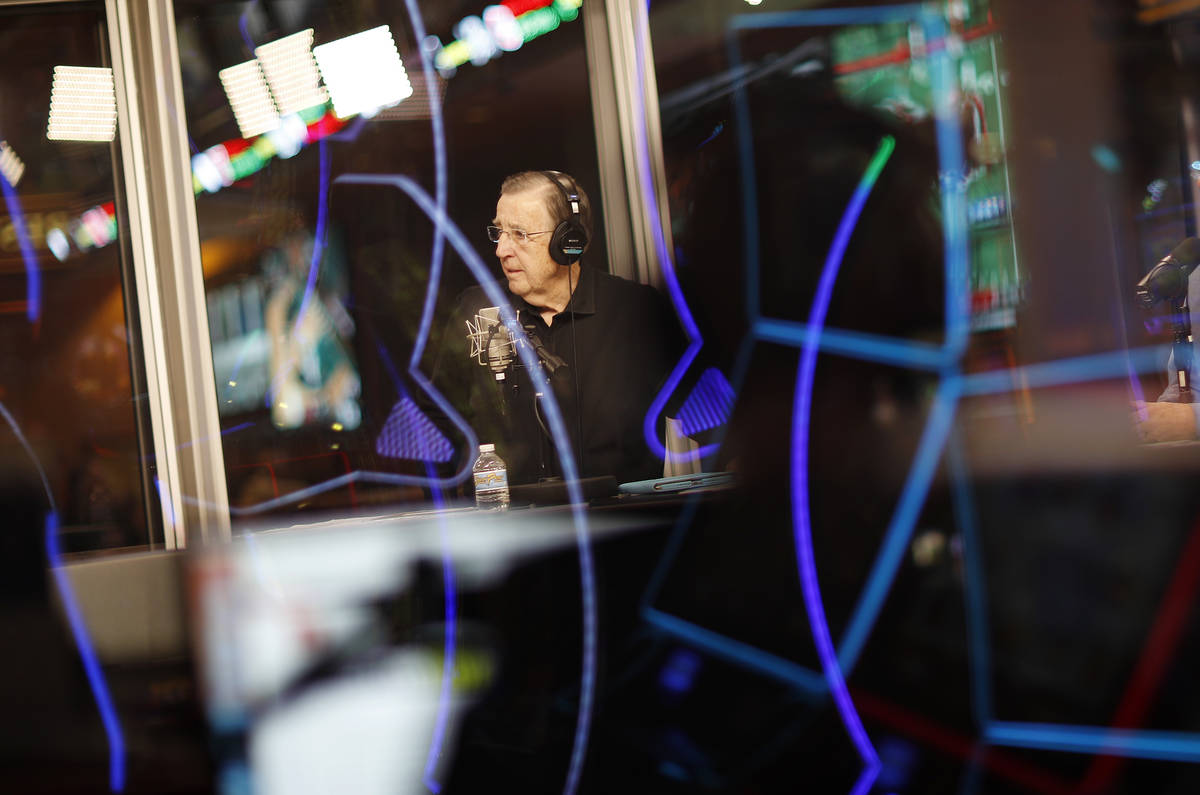 In this Nov. 16, 2017, photo, Brent Musburger broadcasts a show from a glass booth at the South ...